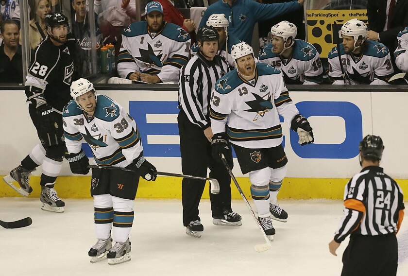 Sharks forward Raffi Torres yells at referee Stephen Walcom after he is called for a penalty after hitting Kings center Jarret Stoll during the second period of a playoff game in 2013.