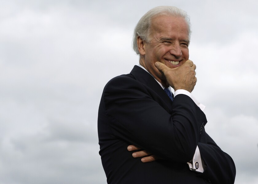 Democratic vice presidential candidate Sen. Joe Biden, D-Del., listens during his stop at Flat Rock Community High School in Flat Rock, Mich., Monday, Sept. 15, 2008. (AP Photo/Paul Sancya)