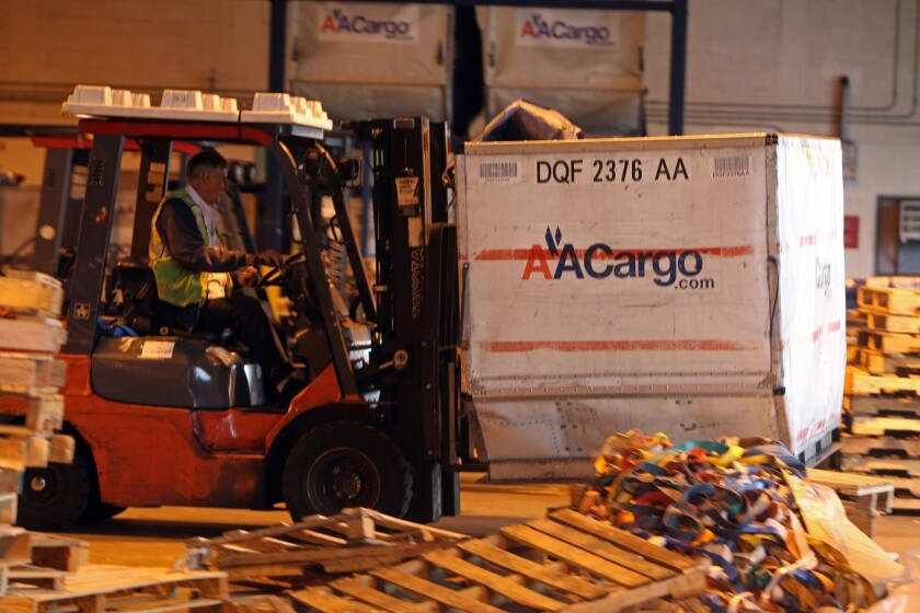 Outbound cargo is moved by American Airlines Cargo at Miami International Airport.