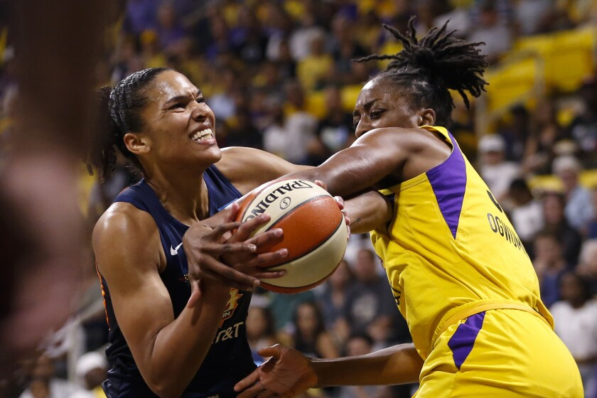 Sparks forward Nneka Ogwumike fouls Sun forward Alyssa Thomas during Game 3 on Sunday.