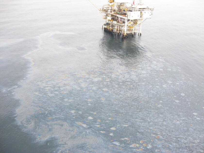 An oil sheen floats near an oil platform off Santa Barbara County's coast. The sheen was caused by natural seepage, the U.S. Coast Guard concluded Monday.