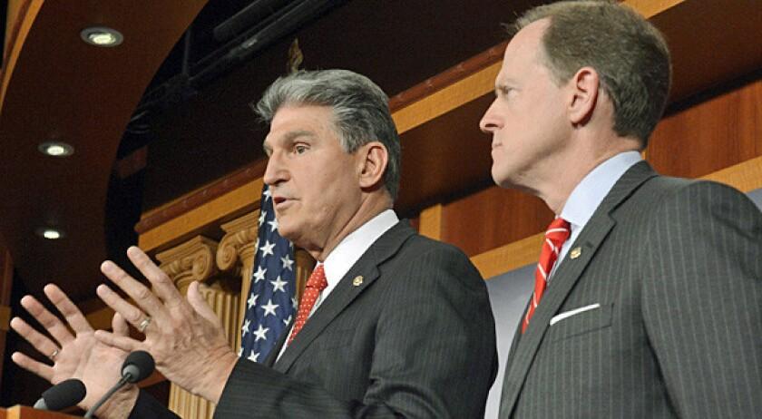 Democratic Senator from West Virginia Joe Manchin, left, and Republican Senator from Pennsylvania Pat Toomey, right, introduce gun control legislation that has bipartisan support.