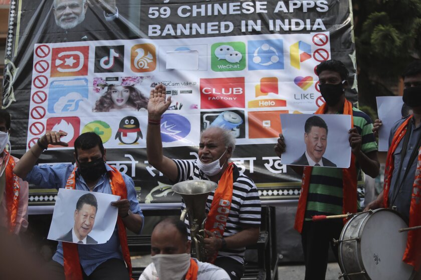 Activists of Jammu and Kashmir Dogra Front shout slogans against Chinese President Xi Jinping during a protest in Jammu, India, Wednesday, July.1, 2020. Indian TikTok users awoke Tuesday to a notice from the popular short-video app saying their data would be transferred to an Irish subsidiary, a response to India's ban on dozens of Chinese apps amid a military standoff between the two countries. The quick workaround showed the ban was largely symbolic since the apps can't be automatically erased from devices where they are already downloaded, and is a response to a border clash with China where 20 Indian soldiers died earlier this month, digital experts said. (AP Photo/Channi Anand)