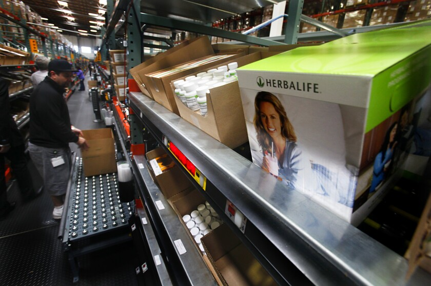 Orders are filled at the Herbalife distribution center in Carson in 2013.