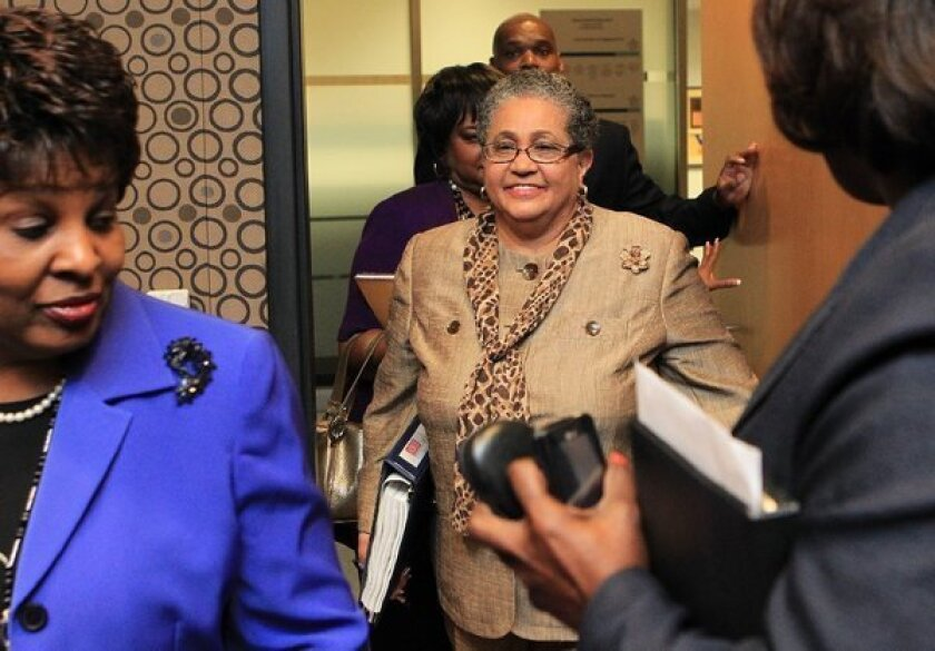 Outgoing schools superintendent Beverly Hall, seen here in 2011, arrives for her last Atlanta school board meeting. She was indicted along with dozens of other other administrators, teachers and principals in one of the nation's largest cheating scandals.