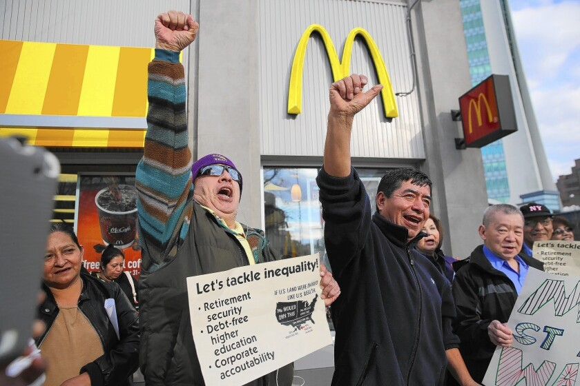 Wage theft trouble spots are agriculture, retail, fast food, hotel housekeeping, janitorial services and construction. Above, activists chant for higher wages Tuesday outside a McDonald's restaurant in Stamford, Conn.
