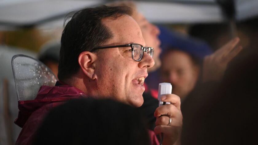 Alex Caputo-Pearl, head of United Teachers Los Angeles, speaks outside John Marshall High School on Monday morning.