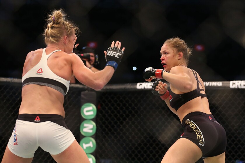 Holly Holm, left, pulled off one of the biggest upsets in UFC history by defeating Ronda Rousey in November 2015 in Melbourne, Australia.