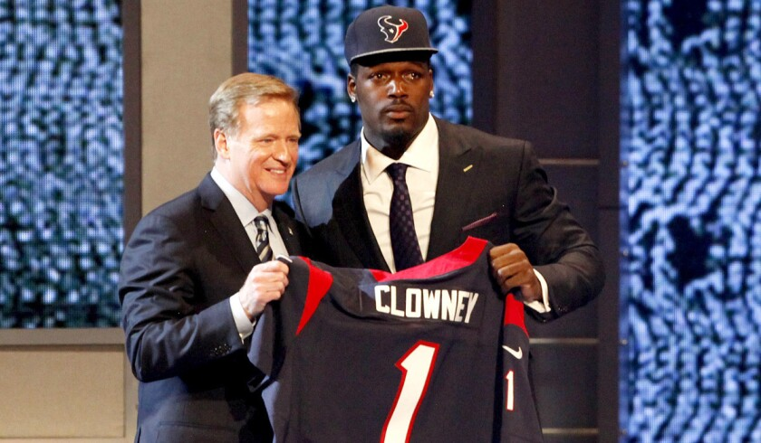 NFL Commissioner Roger Goodell poses with No. 1 overall draft pick Jadeveon Clowney, a defensive end from South Carolina who was selected by the Houston Texans.