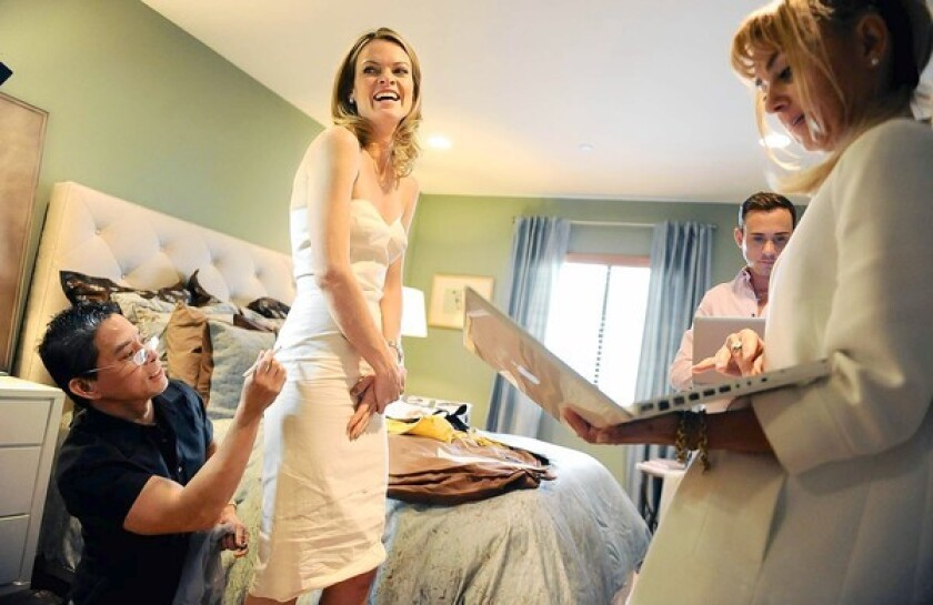 Costume designer Birgit Muller, right, and patternist Angelo Santos, left, are part of the team assembling a Valentina Delfino-designed gown for Missi Pyle.