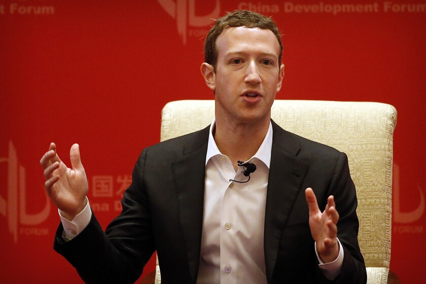 Mark Zuckerberg, shown in China in 2016, says regulation will help consumers feel social media platforms are being held accountable.