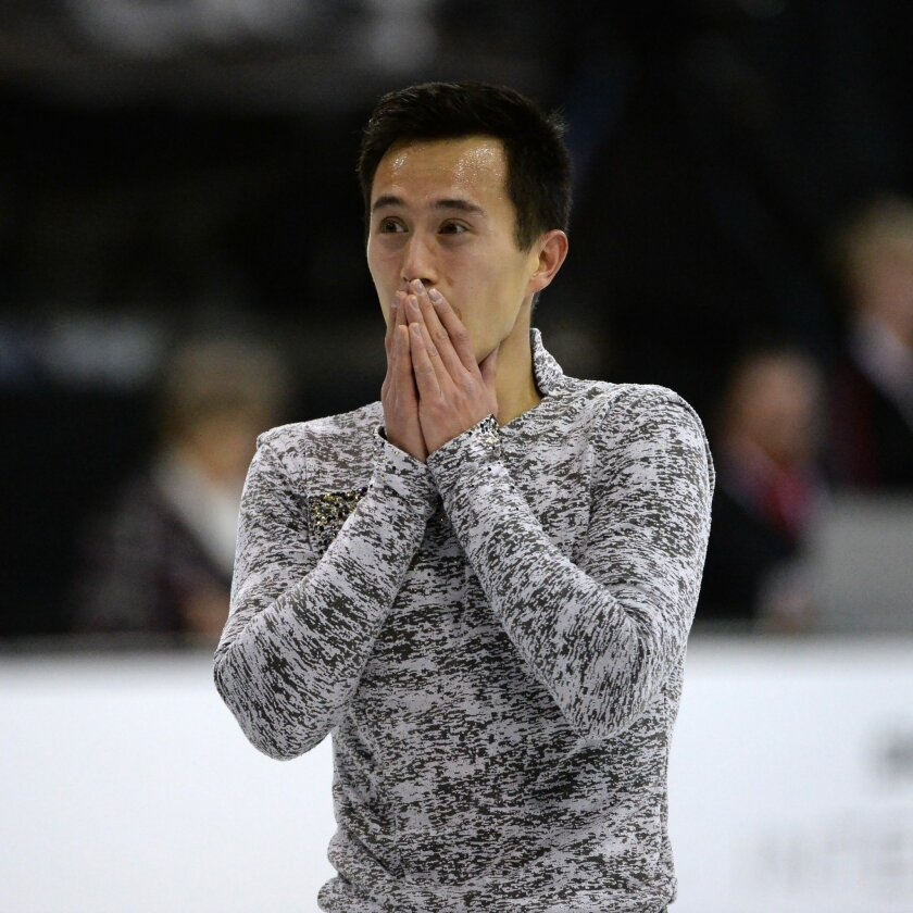 Patrick Chan, of Canada, reacts after his performance in the men's free skating event at the Skate Canada International figure skating competition in Lethbridge, Alberta, Saturday, Oct. 31, 2015. (Jonathan Hayward/The Canadian Press via AP) MANDATORY CREDIT