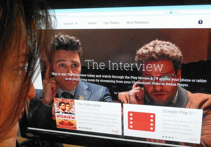 """""""The Interview"""" was streamed or downloaded more than 2 million times over the holiday weekend after it was released via video on demand on Christmas Eve, the day before it hit theaters. Above, a woman looks at a Google Play purchase page of """"The Interview."""""""