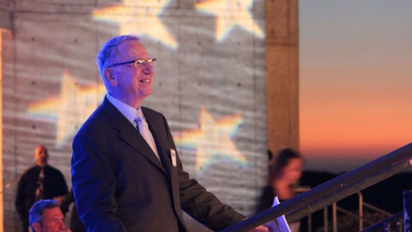 Irwin M. Jacobs walks onto the stage to give opening remarks at the 2015 Symphony at Salk.