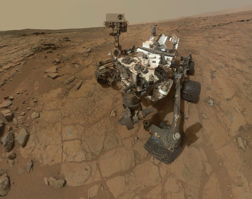 NASA's Mars rover Curiosity, shown at the John Klein drill site, has found signs of nitrates, compounds that could have provided essential nutrients to living things, if they ever existed on the Red Planet.