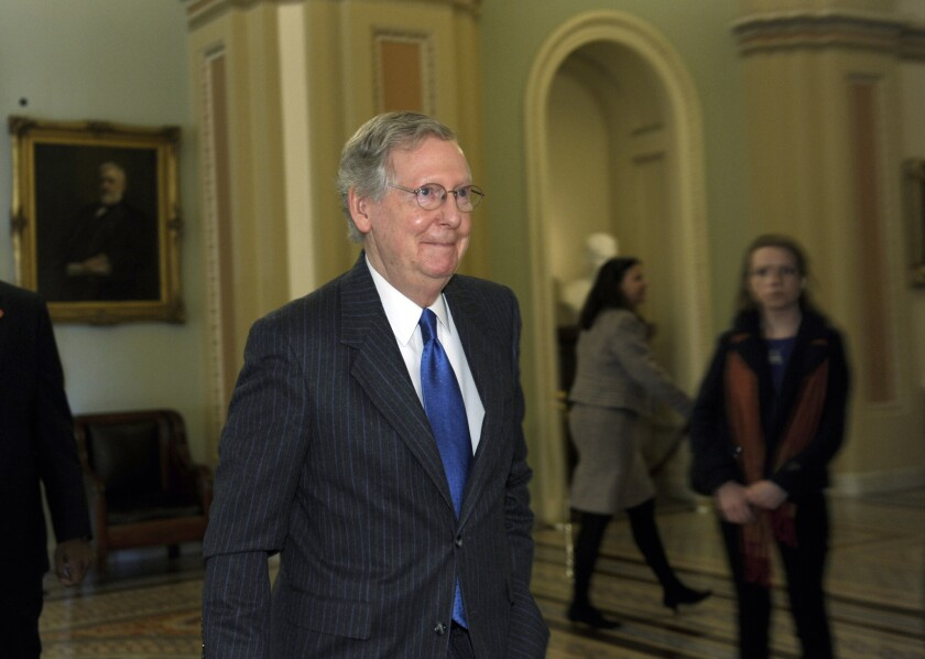 Senate Minority Leader Mitch McConnell (R-Ky.) walks to his office after speaking from the chamber floor.