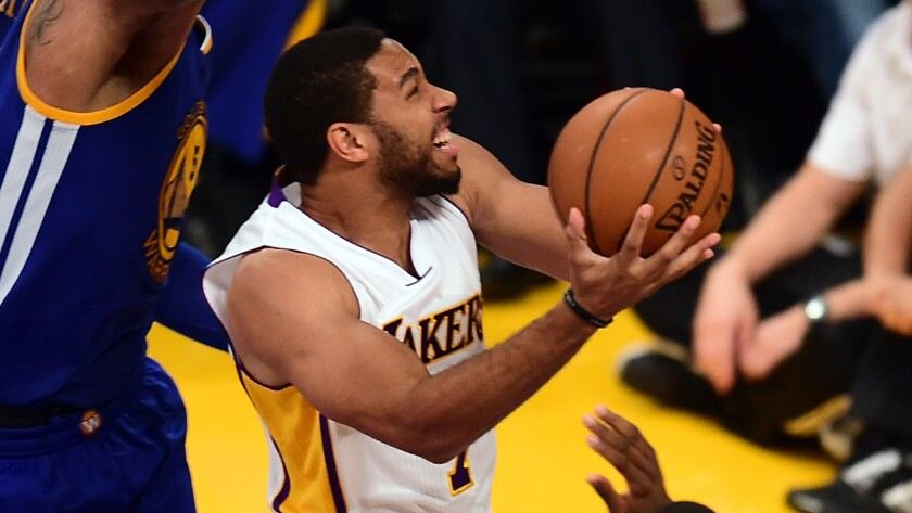 Lakers guard Xavier Henry drives to the basket during a loss to the Golden State Warriors on Nov. 16. Henry tore an Achilles' tendon in practice on Nov. 24 and is out for the season.