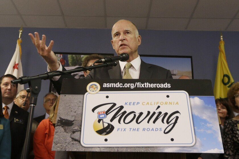 Gov. Jerry Brown speaks at an Oakland news conference about transportation last month. It's unlikely that he'll be able to forge a deal on funding repairs this week.