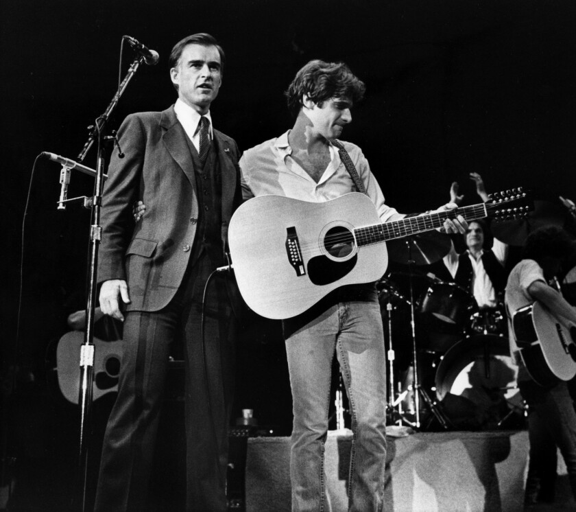 California Gov. Jerry Brown was introduced onstage by Eagles' Glenn Frey, right, during a fundraising concert at the San Diego Sports Arena. This photo was published in the Dec. 24, 1979, Los Angeles Times.