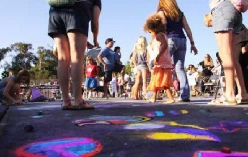 Attendees at last year's Birdstock event used blacktop as a canvas for colorful chalk art. Photo by Pearl Preis