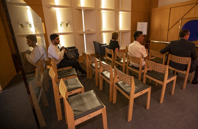Members of the public participate in a mindfulness training class inside the chapel at UCLA Reagan Medical Center on Sept. 23 in Westwood.