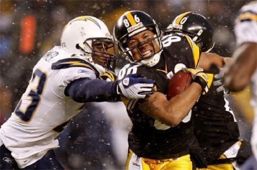 The Steelers' Hines Ward tries to escape the tackle of Chargers  cornerback Quentin Jammer in the Nov. 16 game. (Getty Images)
