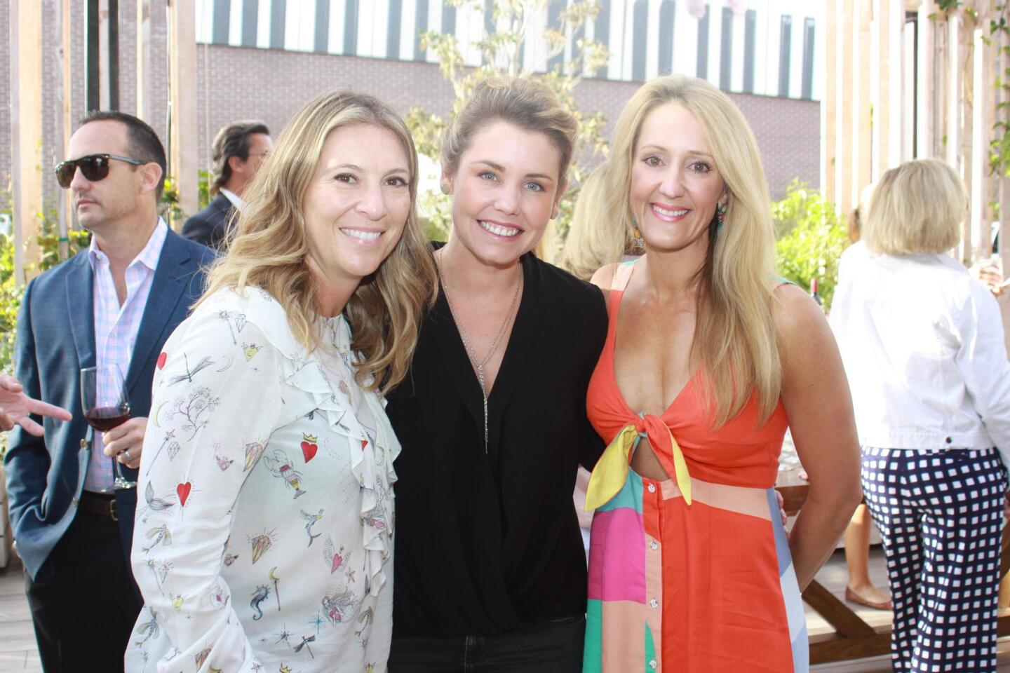 Amy Carr, Jewel Ball chair Jorie Fischer and Katherine Cassidy attend Las Patronas' fundraising cocktail party at The LOT movie theater, April 27, 2017.