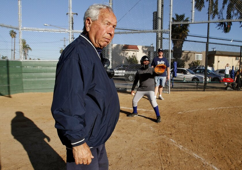 Longtime Little League coach Joe Schloss watches as a throw comes home as his team took infield practice on Tuesday. Schloss, who is in his 80s, starts to prepare his team as Little League in North Park begins another season.