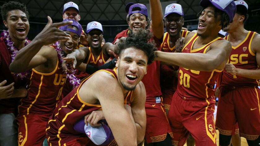 USC's Bennie Boatwright, center, poses with his teammates after winning the championship game of the Diamond Head Classic against New Mexico State on Dec. 25, 2017 in Honolulu.
