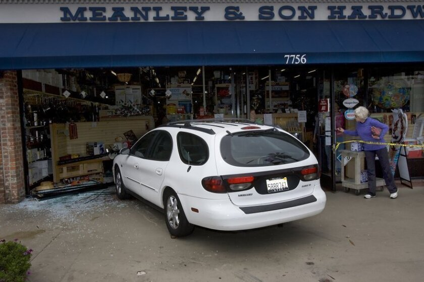 A Ford Taurus wagon is parked in the window of Meanley & Son Hardware store on Girard Avenue in La Jolla on Tuesday, June 30, 2009. International fashion designer Zandra Rhodes accidentally drove her car through the window.