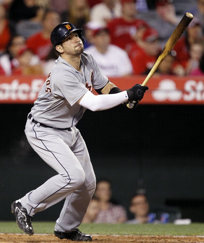 Detroit Tigers' Nick Castellanos hits a sacrifice fly to right field to plate J.D. Martinez during the fourth inning of a baseball game against the Los Angeles Angels in Anaheim, Calif., Saturday, May 30, 2015. (AP Photo/Alex Gallardo)