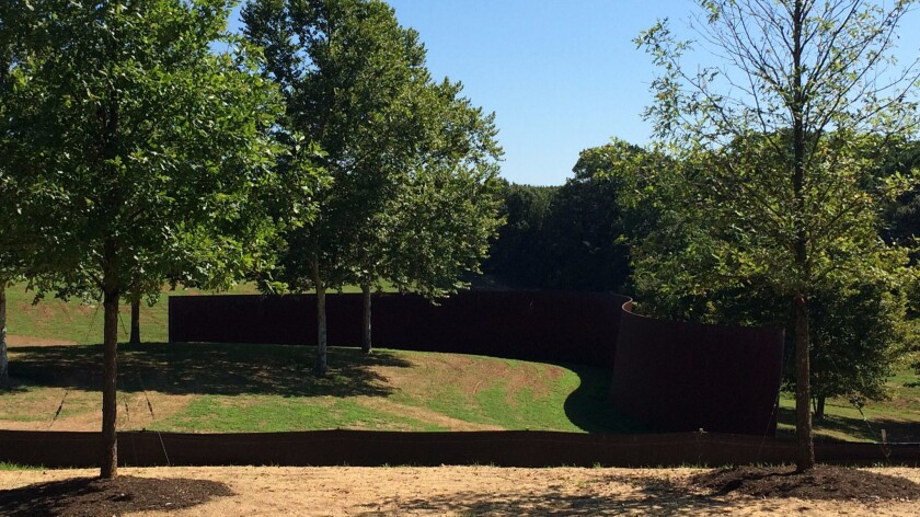 """In the distance, """"Contour 290,"""" by Richard Serra."""