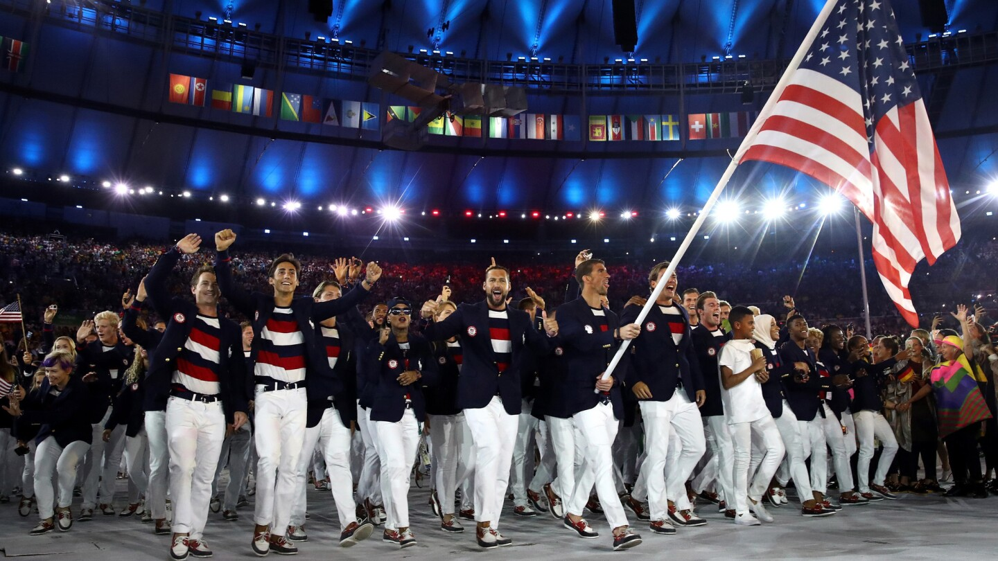 Michael Phelps carries the flag of the United States during the Rio Olympics opening ceremony.