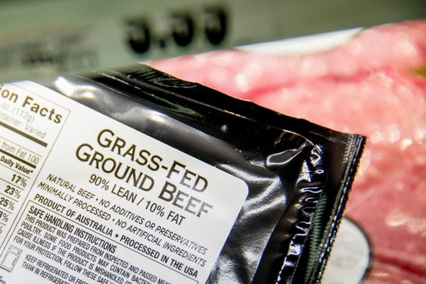 Meat labels are seen at a grocery store in Washington, Tuesday, May 19, 2015. A House committee is moving swiftly to get rid of labels on packages of meat that say where the animals were born, raised and slaughtered. (AP Photo/Andrew Harnik)