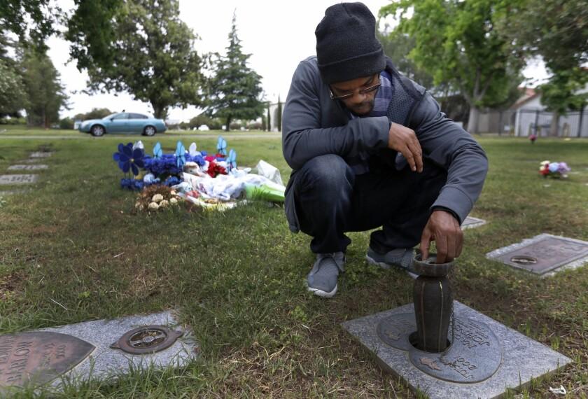 SACRAMRNTO, CA MAY 18, 2019: Zavion Johnson, 35, visits his daughter's grave Sacramento, May 18, 2