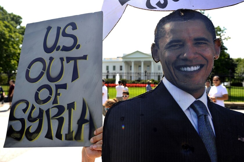 Anti-war demonstrators protest in front of the White House.