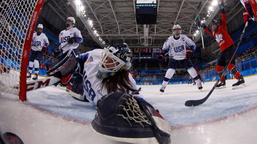 Canada's Meghan Agosta gets the puck past U.S. goaltender Madeline Rooney during a preliminary-round match between the U.S. and Canada at the Pyeongchang Winter Olympics on Feb. 15.