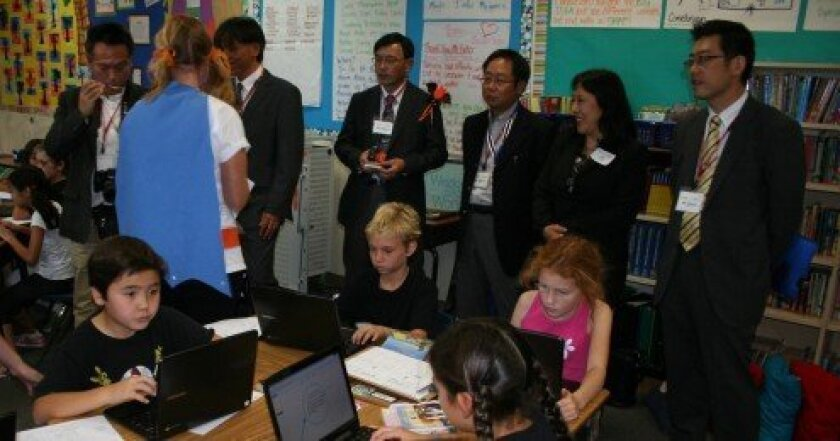 Representatives from the Japanese Ministry of Education toured Del Mar Hills Academy on Oct. 31 to learn about the Del Mar Union School District's integration of technology. Photo/Karen Billing