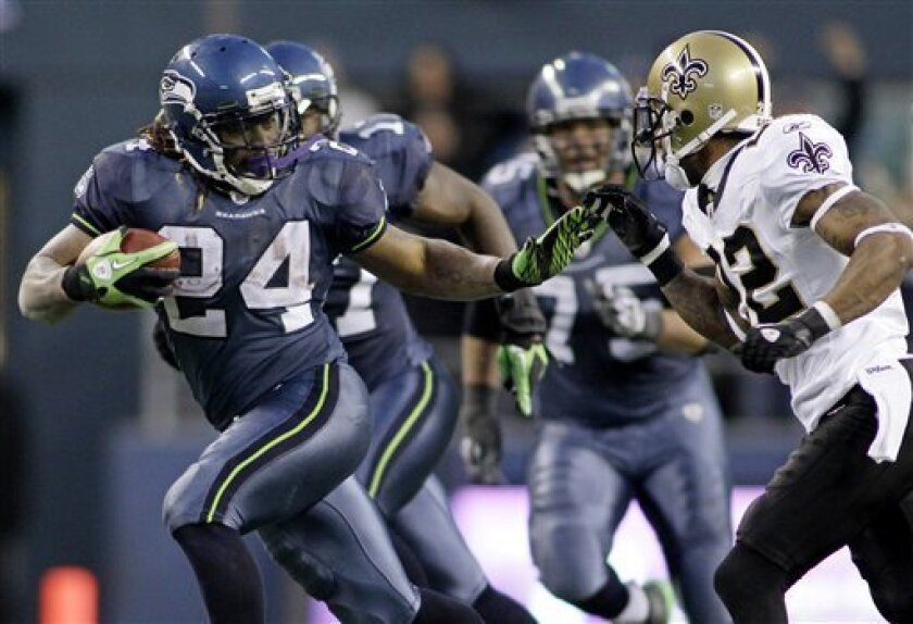 Seattle Seahawks' Marshawn Lynch (24) breaks away from the tackle of New Orleans Saints' Tracy Porter to score a touchdown in the second half of an NFL NFC wild card playoff football game, Saturday, Jan. 8, 2011, in Seattle. The Seahawks won 41-36. (AP Photo/Ted S. Warren)