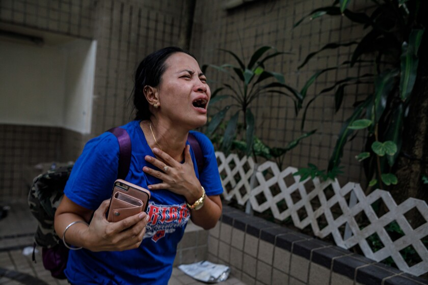 A worker trapped in a Hong Kong park is stricken with tear gas.