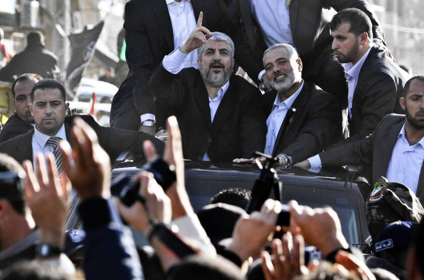 Hamas leader Khaled Meshaal, left, rides in a car with Hamas Prime Minister Ismail Haniyeh after arriving in Rafah, in the southern Gaza Strip. Meshaal had never before set foot in the Palestinian territory, out of fear that Israel would assassinate him if he did.