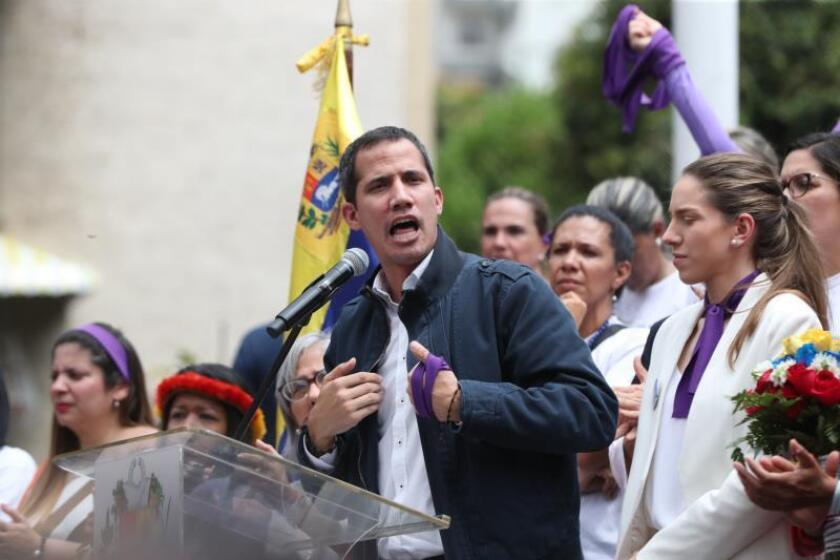 The head of Venezuela's opposition-controlled Parliament and self-proclaimed interim president, Juan Guaido (L), and his wife Fabiana Rosales (R) attend a demonstration to commemorate the International Women's Day, at the Palos Grandes Square, in Caracas on March 8, 2019. EFE-EPA/ Raul Martinez