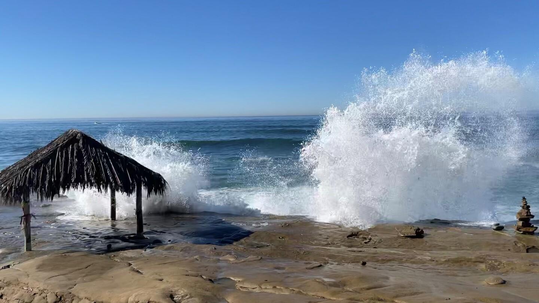 Waves break on the rocks next to the Windansea Beach hut.
