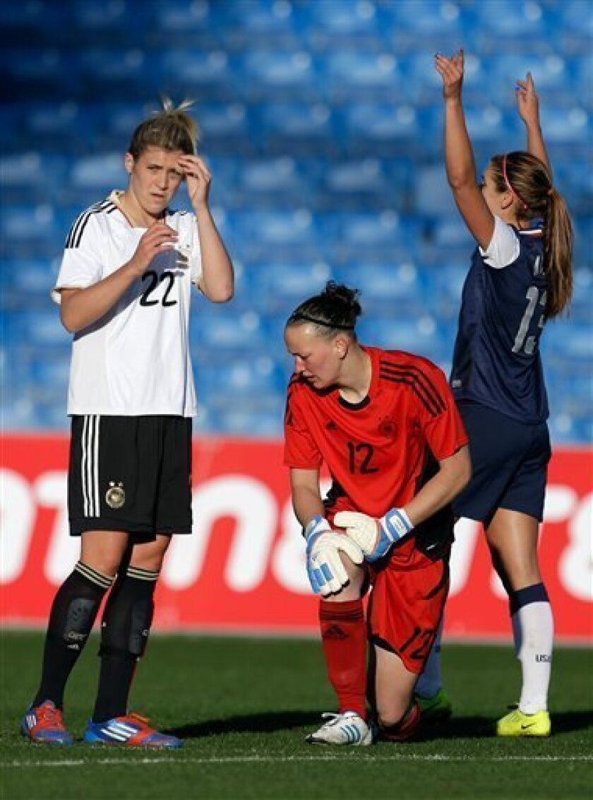 Germany's Luisa Wensing, left, and goalkeeper Almuth Schult react after Alex Morgan, right, of the US, scored her second goal during their Algarve Cup women's soccer final match Wednesday, March 13 2013, at the Algarve stadium outside Faro, southern Portugal. (AP Photo/Armando Franca)
