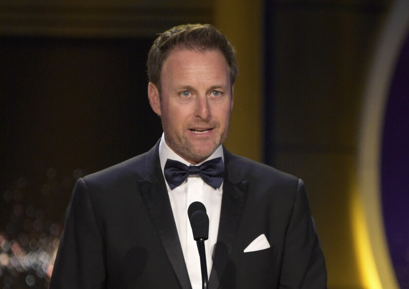 """FILE - In this April 29, 2018, file photo, Chris Harrison presents the award for outstanding entertainment talk show host at the Daytime Emmy Awards at the Pasadena Civic Center in Pasadena, Calif. Harrison will not host the upcoming season of """"The Bachelorette"""" following controversy over racially insensitive comments, and will instead be replaced with two former contestants, ABC Entertainment and Warner Horizon said in a statement Friday, March 12, 2021. (Photo by Richard Shotwell/Invision/AP, File)"""