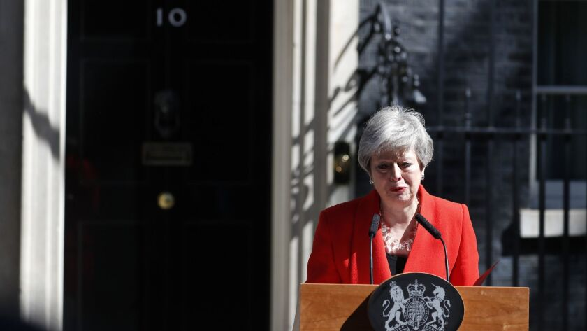 FILE - In this Friday, May 24, 2019 file photo, British Prime Minister Theresa May reacts as she mak
