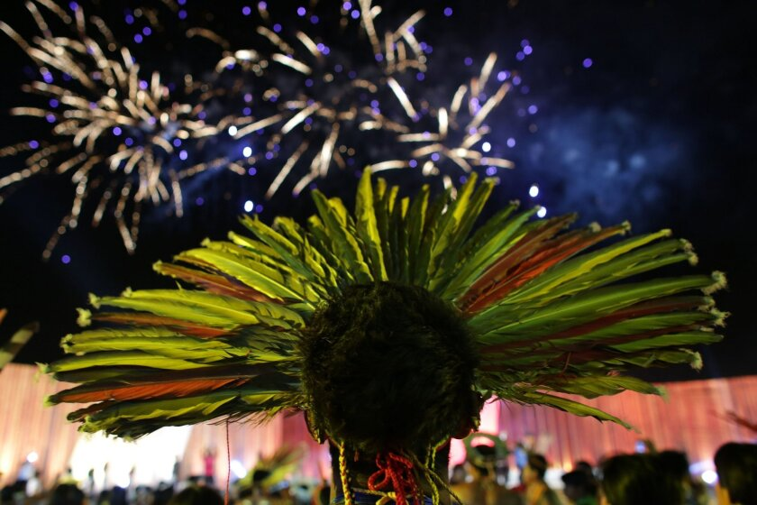 A Brazilian Bororo indigenous attends the closing ceremony of the World Indigenous Games, in Palmas, Brazil, Saturday, Oct. 31, 2015. The first edition of the World Indigenous Games, which brought nearly 2,000 delegates representing first nations from across the globe to a remote outpost in the hea