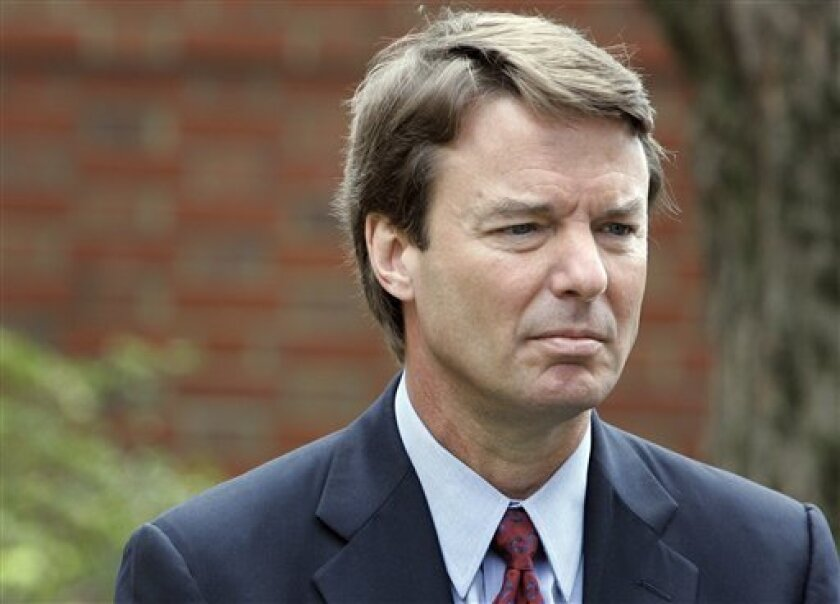 FILE - In this March 22, 2007, file photo Democratic presidential hopeful John Edwards listens to his wife Elizabeth, not shown, talk to media about her recurrence of cancer during a news conference in Chapel Hill, N.C. The legal case against two-time presidential candidate focuses on where to draw the line between the public and private in a politician's life. The central dispute over Edwards' indictment on felony charges is whether money, spent by two supporters to keep his mistress in hiding, were campaign contributions or private gifts from friends. (AP Photo/Gerry Broome, File)