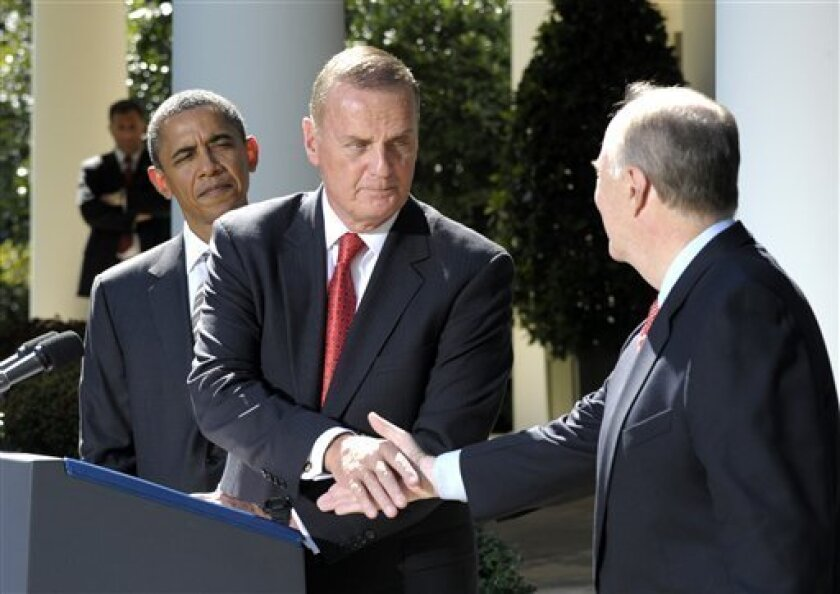 President Barack Obama watches as outgoing National Security Adviser James Jones, center, shakes hands with his replacement Tom Donilon, Friday, Oct. 8, 2010, in the Rose Garden of the White House in Washington. (AP Photo/Susan Walsh)