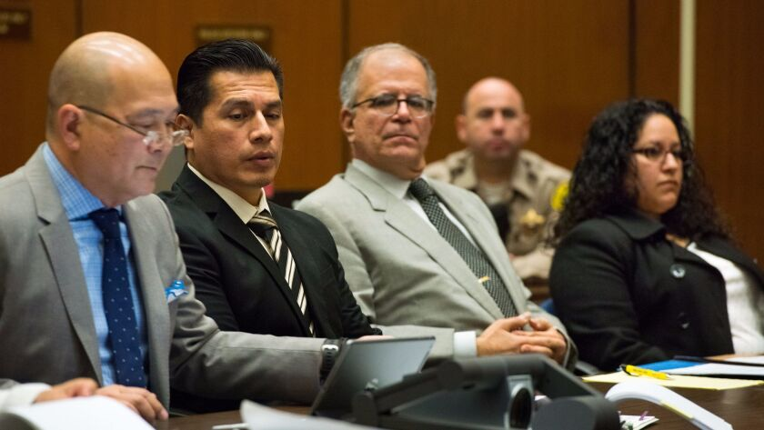 Defense attorney William Seki, from left, Los Angeles Police Department Officer Rene Ponce, defense attorney Ira Salzman and LAPD Officer Irene Gomez listen to testimony during a preliminary hearing earlier this year.
